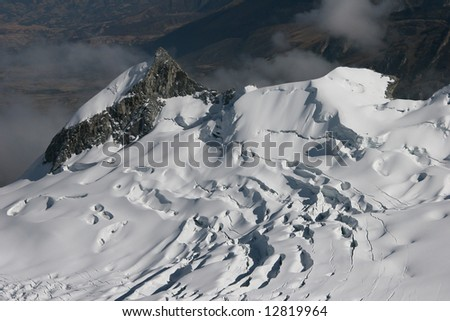 View from top of mountain Vallunaraju (5.686 m), in background Huascaran, Andes, Peru - stock photo