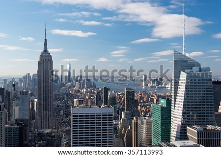 View from Top of the Rock on the Empire State building, Freedom Tower and financial district, Statue of Liberty and the Hudson river. - stock photo