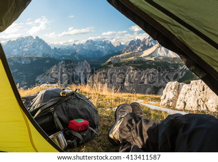 view from touristic tent to mountain valley, Dolomites, Italy - stock photo