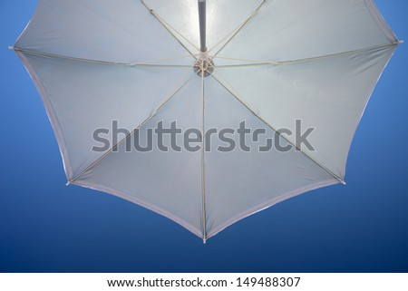 View from under a beach umbrella - stock photo