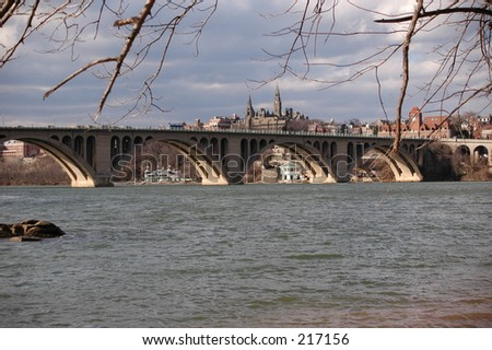 View from Virginia side of the Potomac to Key Bridge and Georgetown - stock photo