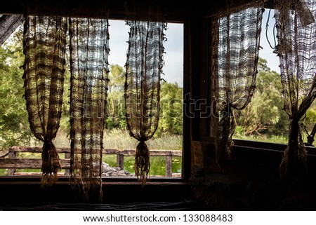 view from window with old curtains - stock photo