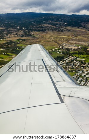View from Windowseat over the Wing of Airline Jet - stock photo
