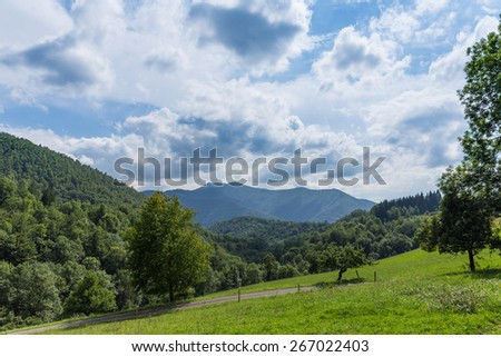 View from within the Pyrenees towards a montain range - stock photo