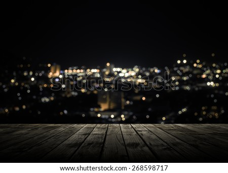 View from wooden plank above phuket town at night - stock photo