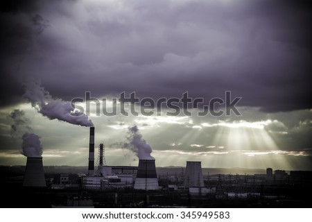View in thermal power plants. Through the large clouds punched bright sunlight.  - stock photo