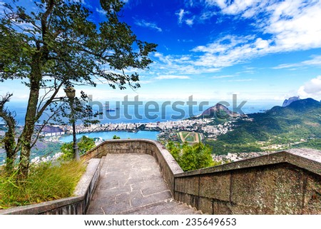 View into Rio de Janeiro from the steps at Christ the Redeemer statue - stock photo