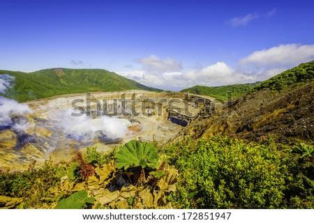 View into the main crater of the Poas Volcano in Costa Rica. - stock photo