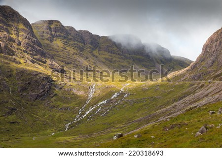 View into the misty Highlands and over the plains next to Loch Kishorn, Scotland - stock photo