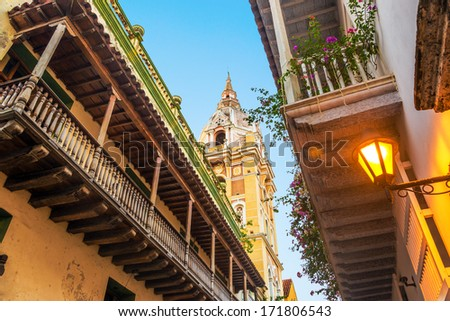 View looking up at historic colonial balconies and a church in Cartagena, Colombia - stock photo