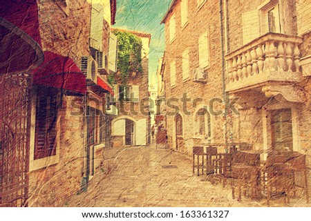 view narrow street in old district of Budva, Montenegro. Picture in artistic retro style. - stock photo