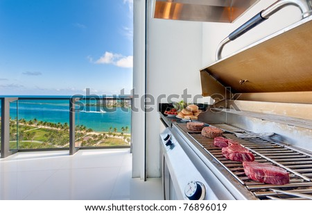 View of a barbecue in an luxury terrace with ocean view. - stock photo