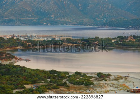 View of a beautiful bay with azure sea from top of a hill, Villasimius, Sardinia, Italy - stock photo