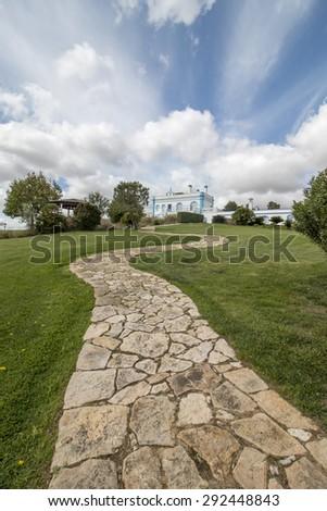 View of a beautiful estate villa on top of a hill located in the Alentejo region, Portugal. - stock photo
