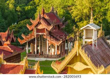 View of a beautifully carved temple on the Mandalay Royal Palace grounds - stock photo