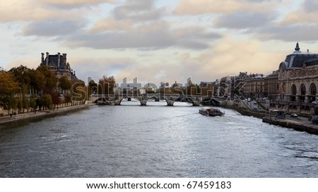 View of a bridge and the seine river in Paris at the evening - stock photo