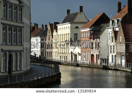 View of a canal in Bruges (Belgium) with rainy sky - stock photo