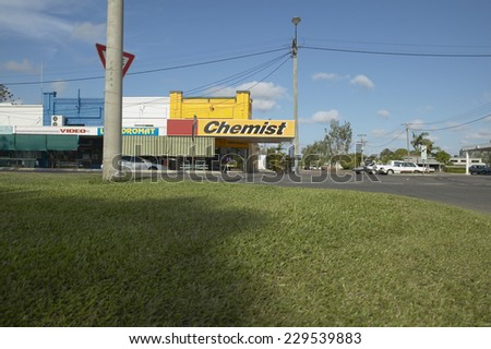 View of a 'Chemist' shop in suburban neighborhood - stock photo