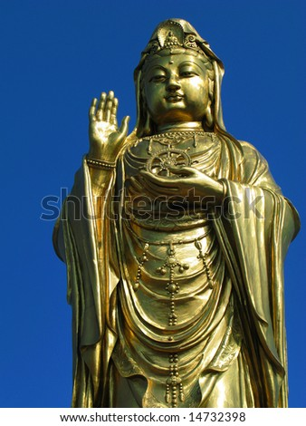 View of a chinese god in front of a temple - stock photo