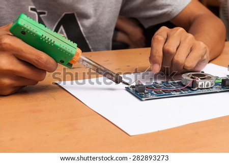 View of a circuit board being repaired. - stock photo