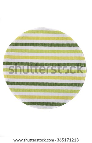 View of a circular mat for placing plates when having a meal. - stock photo