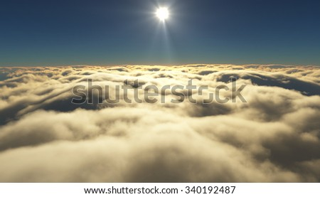 View of a cloudy sunrise while flying above the clouds. - stock photo