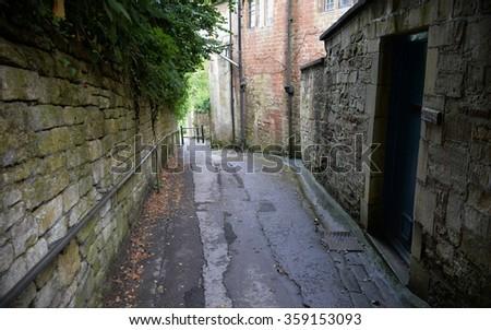 View of a Dark Empty Alleyway - stock photo