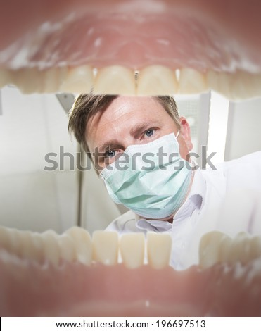 View of a dentist from the inside of mouth - stock photo