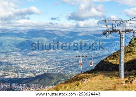 View of a gondola named the TeleferiQo climbing the Andes mountains outside of Quito, Ecuador - stock photo