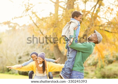 View of a happy young family on an autumns day - stock photo