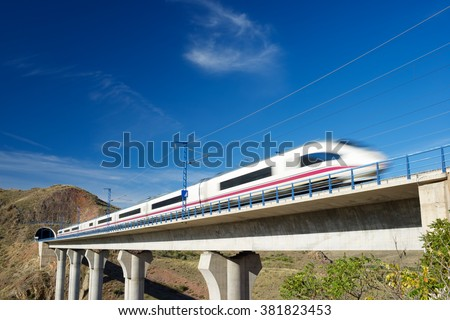 view of a high-speed train crossing a viaduct in Purroy, Zaragoza, Aragon, Spain.  - stock photo