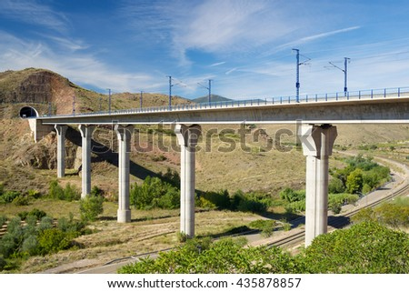 view of a high-speed viaduct in Purroy, Zaragoza, Aragon, Spain. AVE Madrid Barcelona. - stock photo