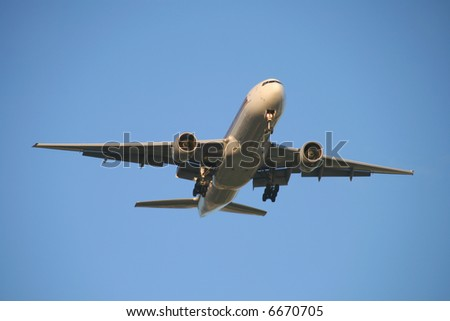 view of a jet plane on final approach - stock photo
