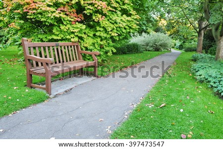 View of a Leafy Pathway in a Beautiful Green Park - stock photo