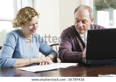 View of a mature couple working together - stock photo
