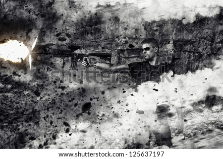 View of a menacing man firing a machine gun in an action scene with explosions on a stone quarry. - stock photo
