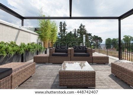 View of a modern patio with comfortable garden furniture - stock photo