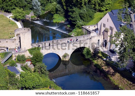 View of a old stone bridge, city Luxembourg in Luxembourg - stock photo