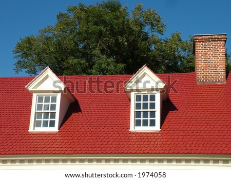 View of a red roof of a family house - stock photo