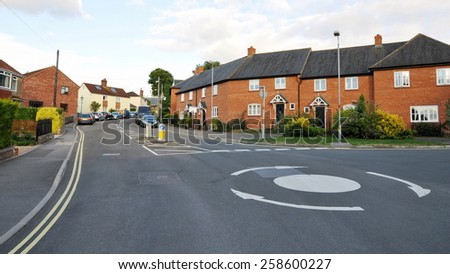 View of a Roundabout on a Road in a Typical British Town - stock photo