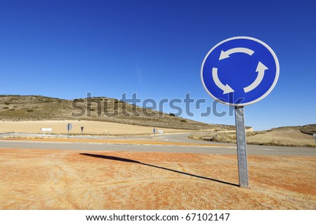 view of a roundabout signal with blue sky - stock photo