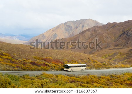 View of a tour bus taken from Polychrome Pass in Denali National Park, Alaska - stock photo