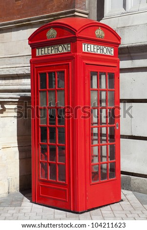 View of a traditional red London phone booth - stock photo