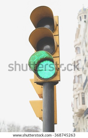 View of a traffic light in the foreground with a building behind - stock photo