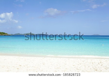 View of a tropical ocean from white sand beach  - stock photo