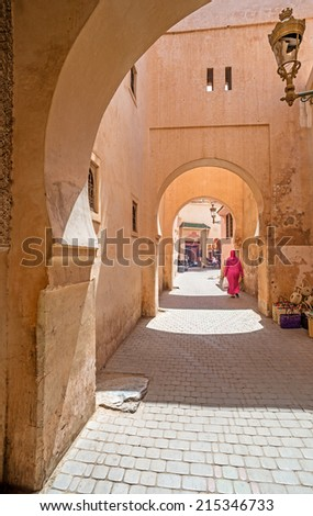 View of a typical street in the old town of Marrakech in Morocco - stock photo