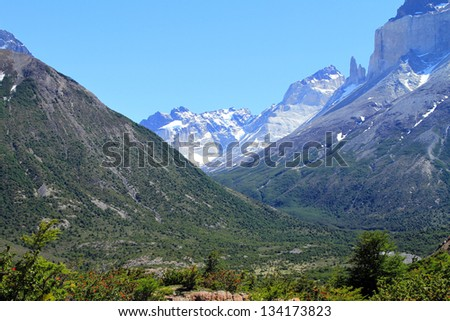 View of a valley between the immense mountains. Shot in Patagonia, South America. - stock photo