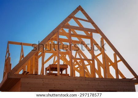 view of a wooden house construction site - stock photo