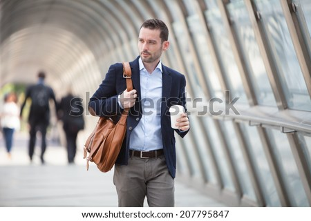 View of a Young attractive man drinking coffee on his way - stock photo