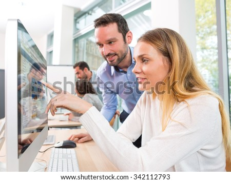 View of a Young attractive people taking a training course with formator - stock photo